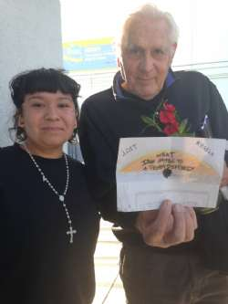 Holocaust Survivor Peter Daniels with a student at Locke High School, following Peter's visit to her classroom.